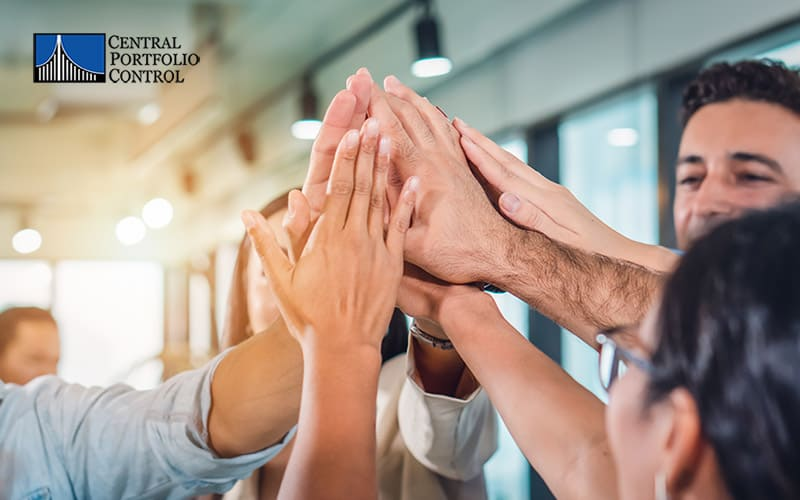 Central Portfolio Control celebrates success with employees by giving a high-five in their workplace
